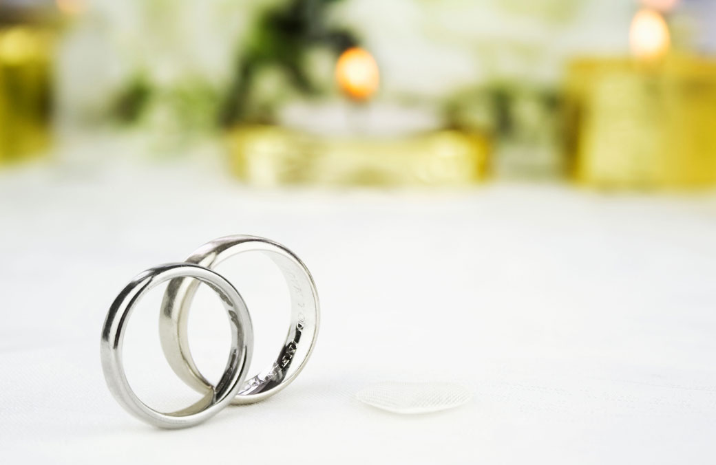 Bride and groom gold and white gold wedding rings.